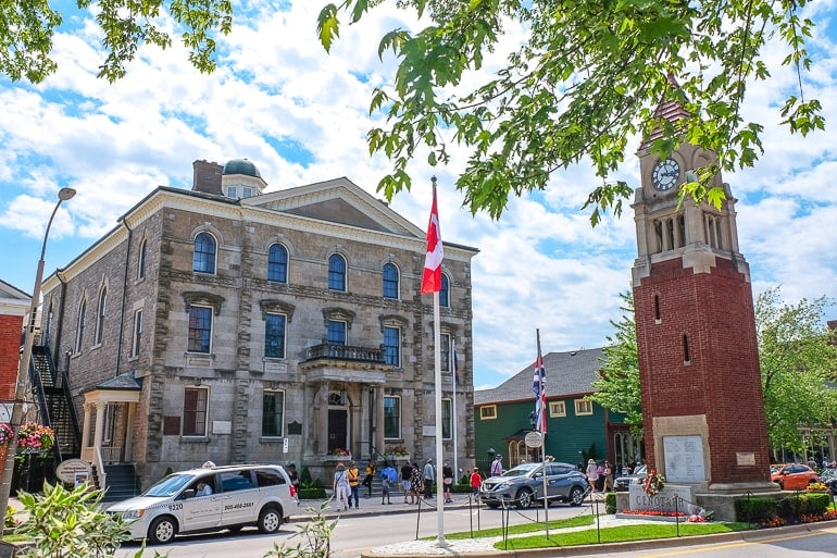 old courthouse building and clock tower across town street in niagara on the lake