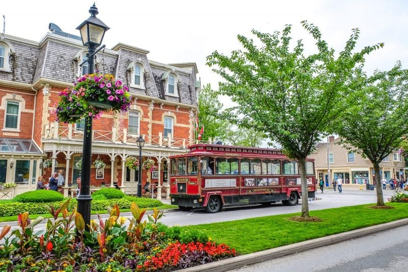 red trolley on street outside old hotel things to do in niagara on the lake ontario