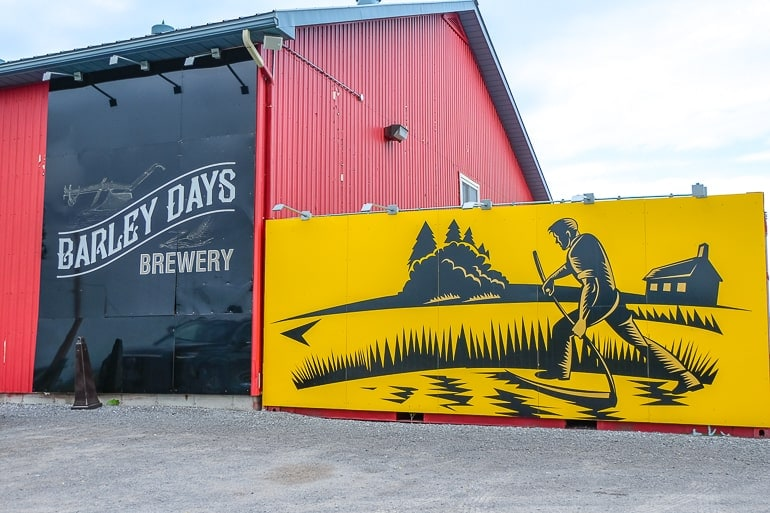 red steel barn with yellow logo at brewery
