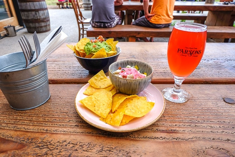 tortilla chips on plate with beer on wooden table parson brewery