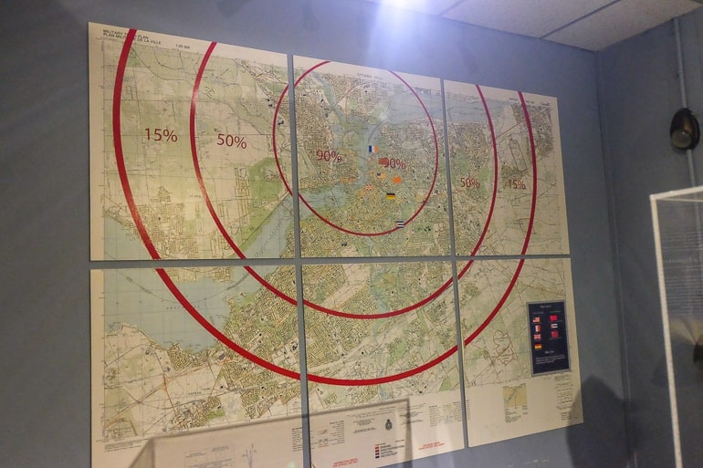 map with red circles on wall