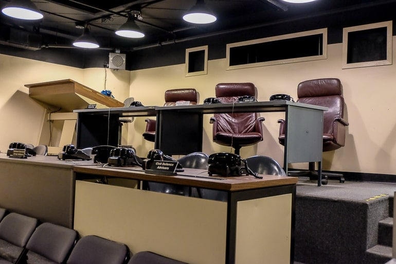 old leather chairs with desk and phones in bunker room