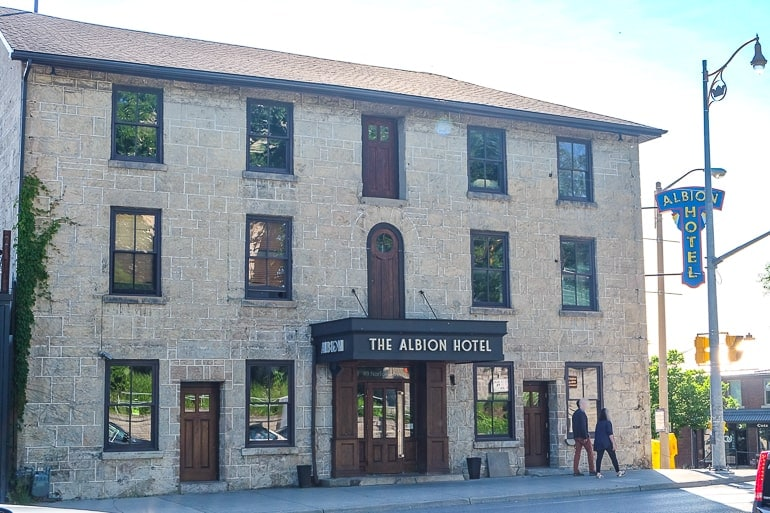 old stone hotel building on street corner bars in guelph