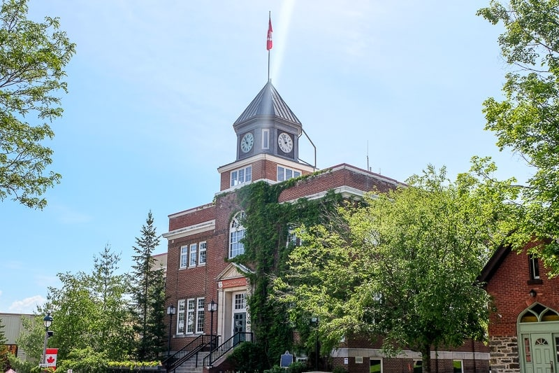 old town hall building with clock above in huntsville ontario