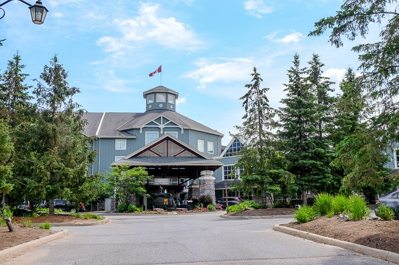 large blue building with entrance to ontario resort underneath