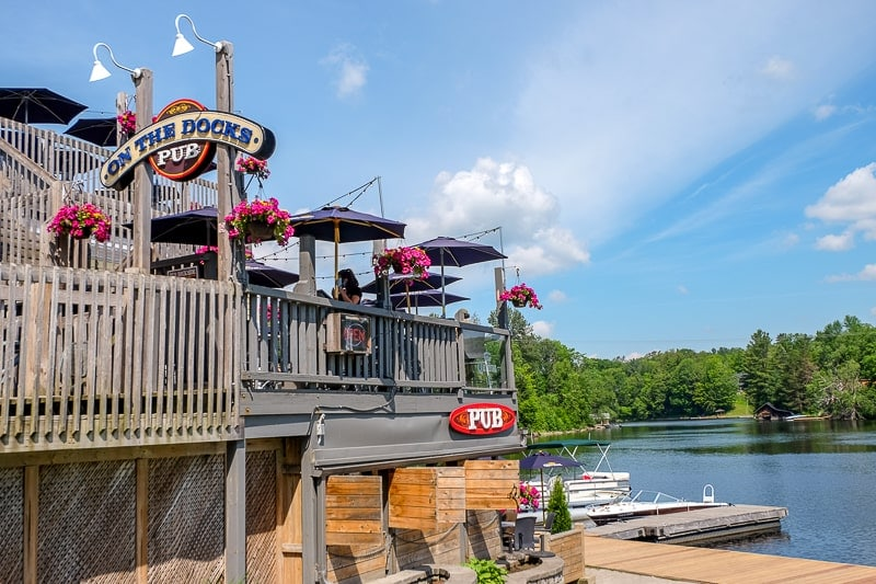 wooden raised deck of pub by river huntsville ontario