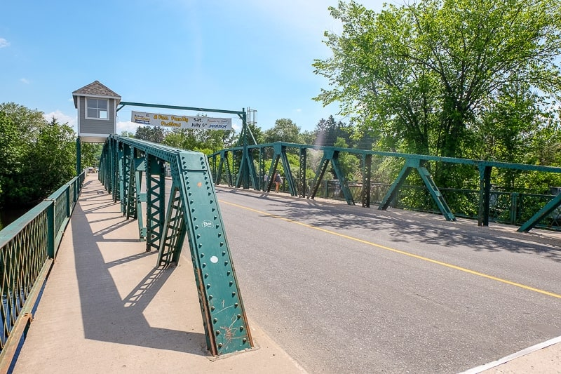 green metallic bridge with roadway swing bridge huntsville ontario