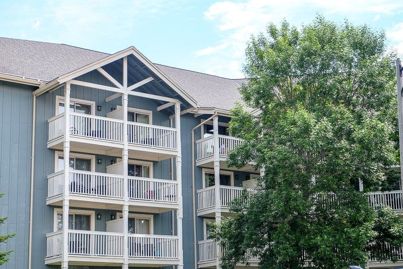 white balconies on blue accommodation building deerhurst resort huntsville