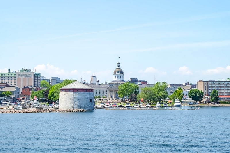 blue water with historic kingston ontario in background