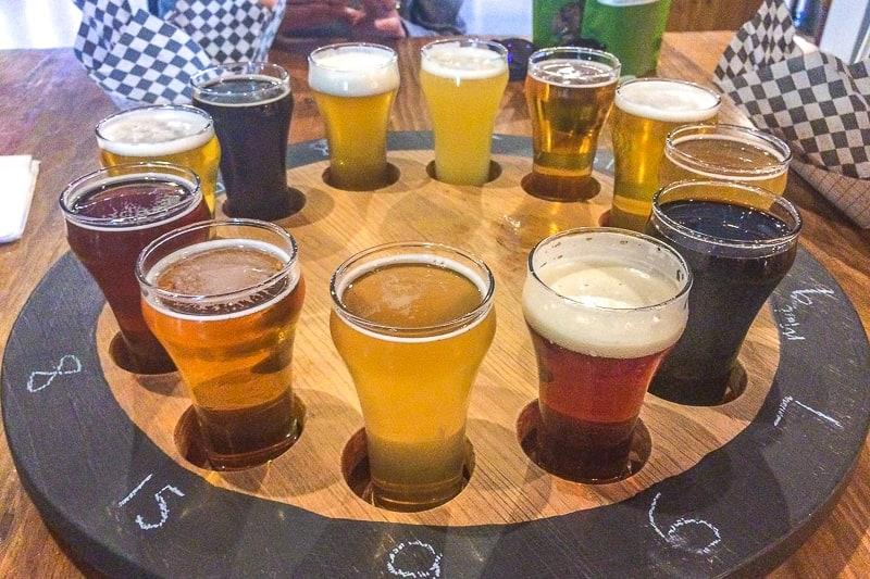 circle of craft beer sample glasses on table in ontario weekend getaway