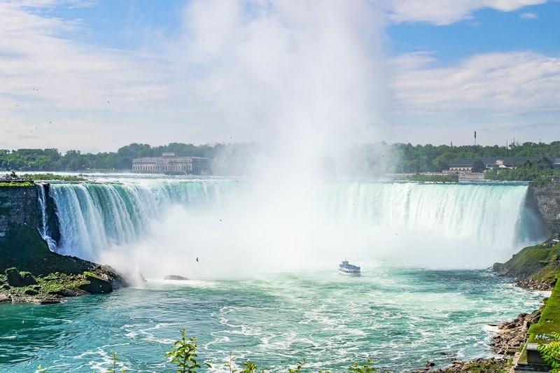 niagara falls waterfall with boat in water in front weekend getaway ontario