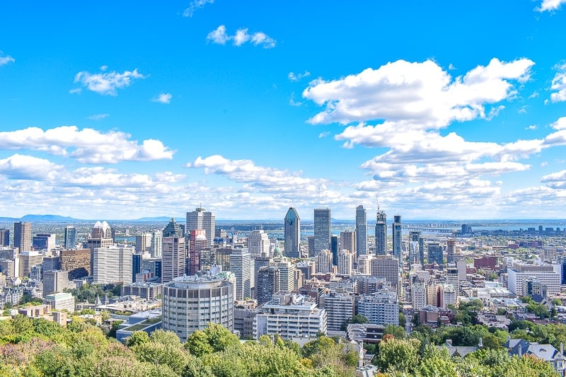 downtown montreal high rise buildings from vantage point with blue sky behind