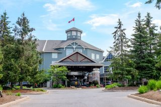 blue muskoka resort entrance with green trees in front where to stay in muskoka