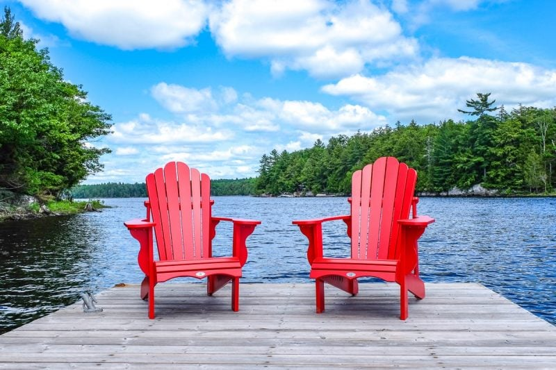 red chairs on wooden dock with lake behind things to do in ontario