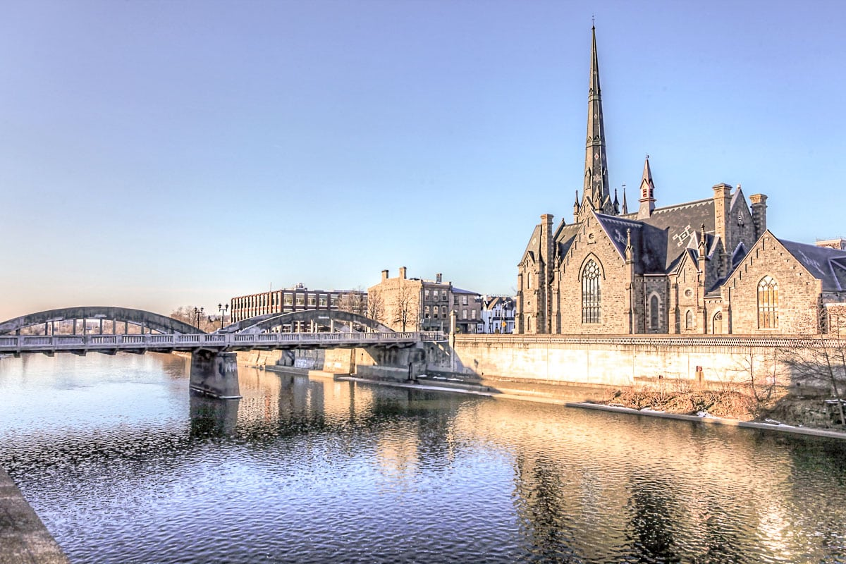 church with tower along grand river in cambridge ontario