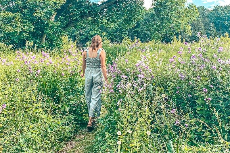 woman wandering through tall grass in cambridge ontario