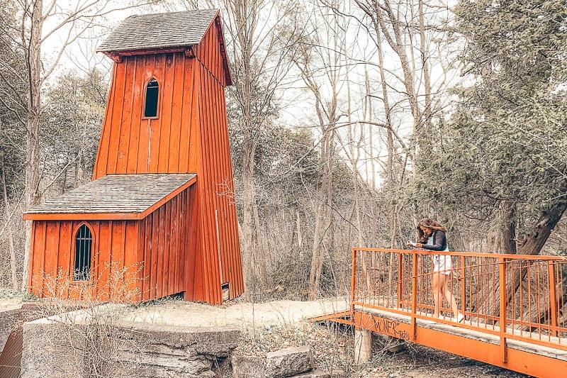orange wooden tower with bridge in the woods in cambridge ontario