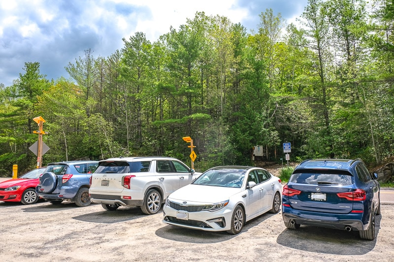 cars parked in lot beside road near eagles nest lookout trail